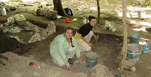 Amanda Sinclair and fellow Trent student learn excavating skills hands-on in Belize