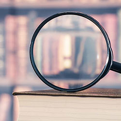 Magnifying glass on books