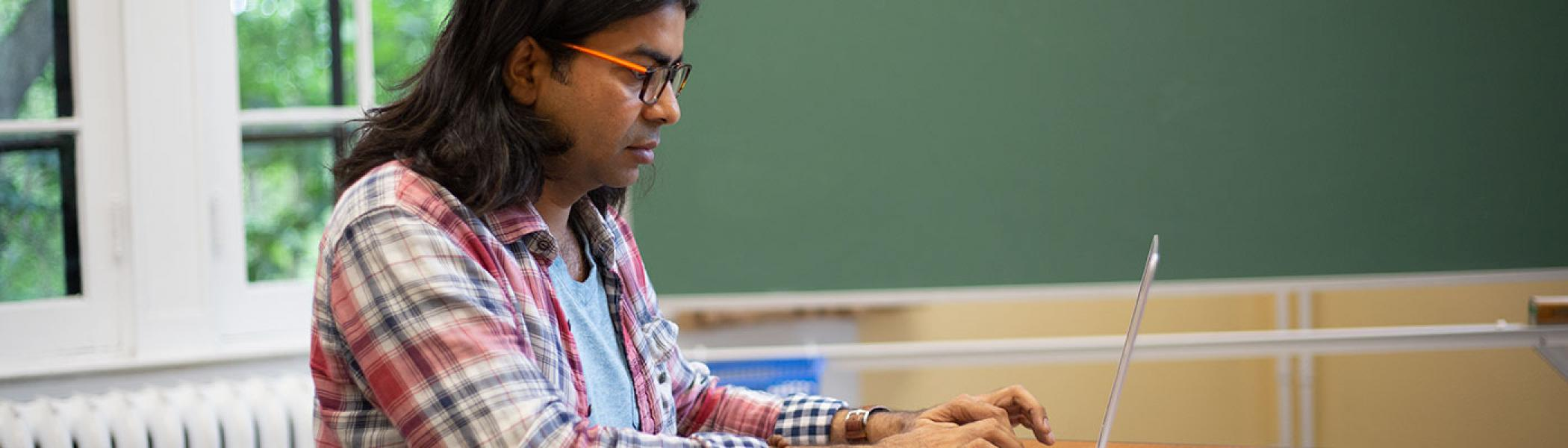 A student on his computer