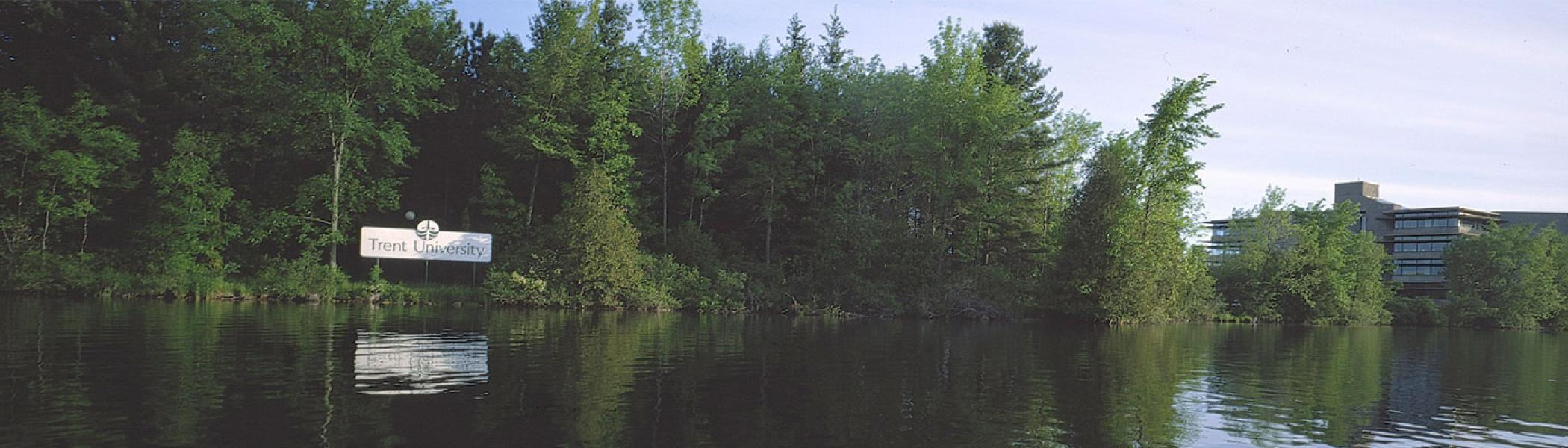 View of sign from across the river, text says Trent University