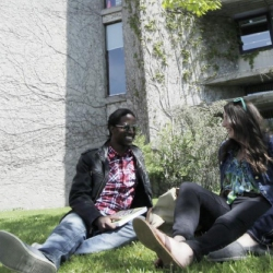 Trent students sitting on the grass outside Bata library