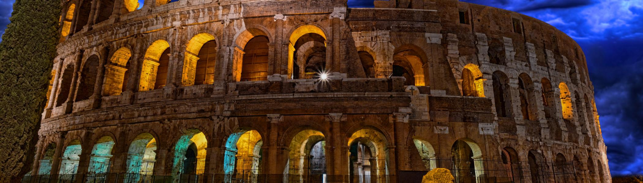 coliseum at night lit from the inside