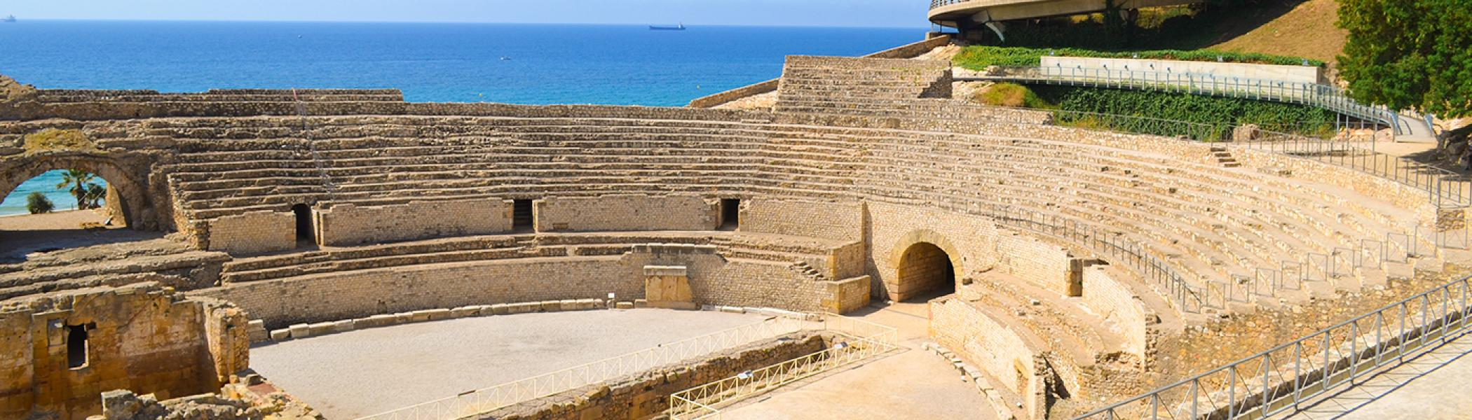 coliseum at noon beside the sea