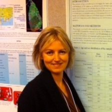 Anne Keenleyside standing in front of conference posters