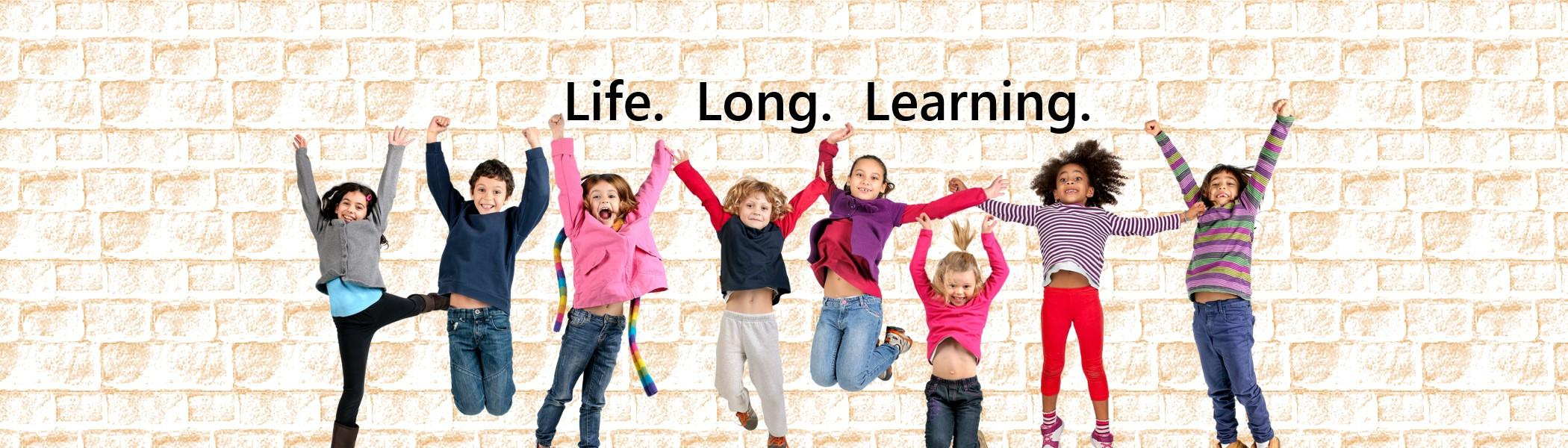 Children in a row jumping up with the words life long learning above them