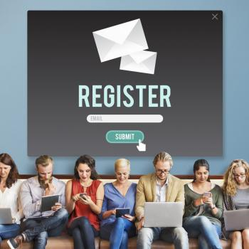 7 people sitting in a row below a sign that says Register; using their laptops, iPads and phones