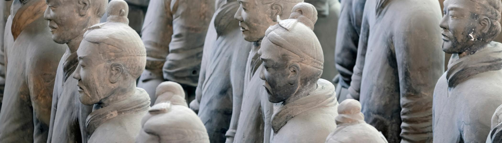 stone statues of chinese men from ancient cultures studied in the archaeology program at Trent university
