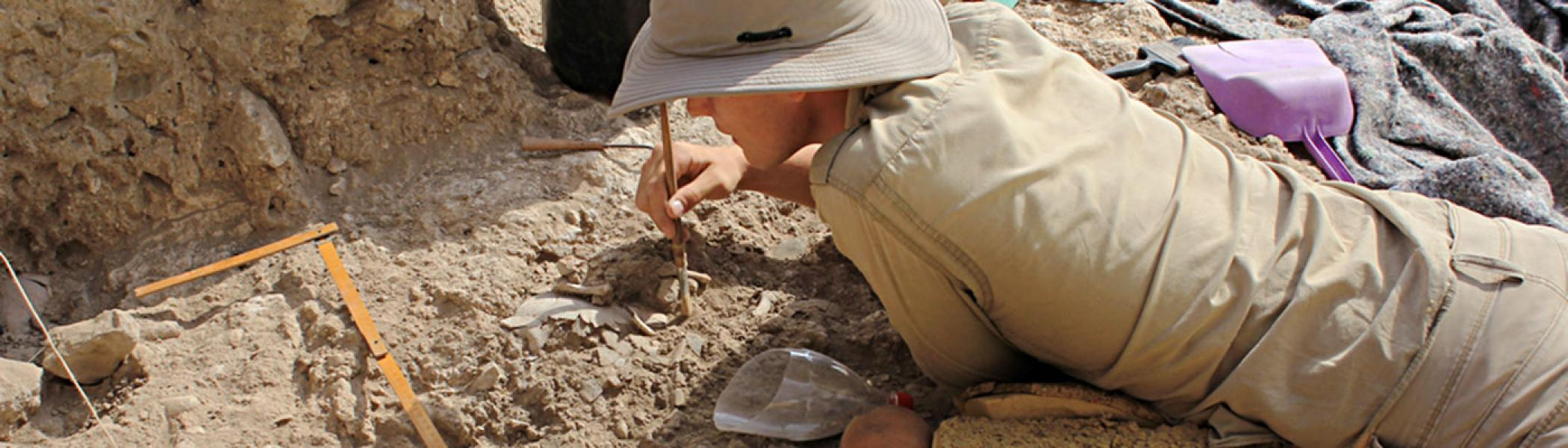 Archaeologist excavating at Nahal Ein Gev II, Jordan