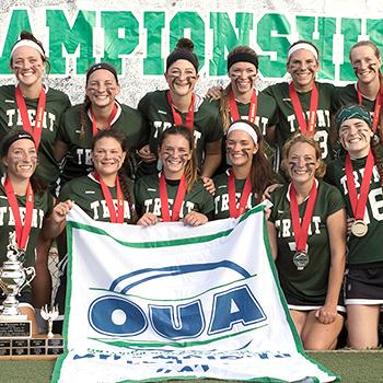 Group Photo of Trent Excalibur Women's Lacrosse celebrating OUA win