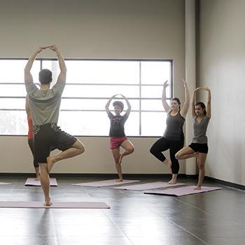 An instructor teaches a yoga class