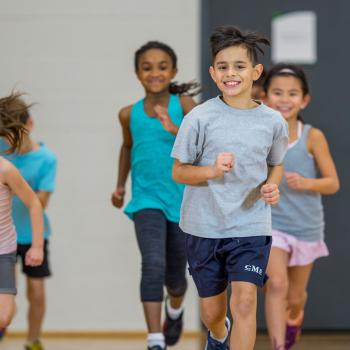 Children running in a gymnasium