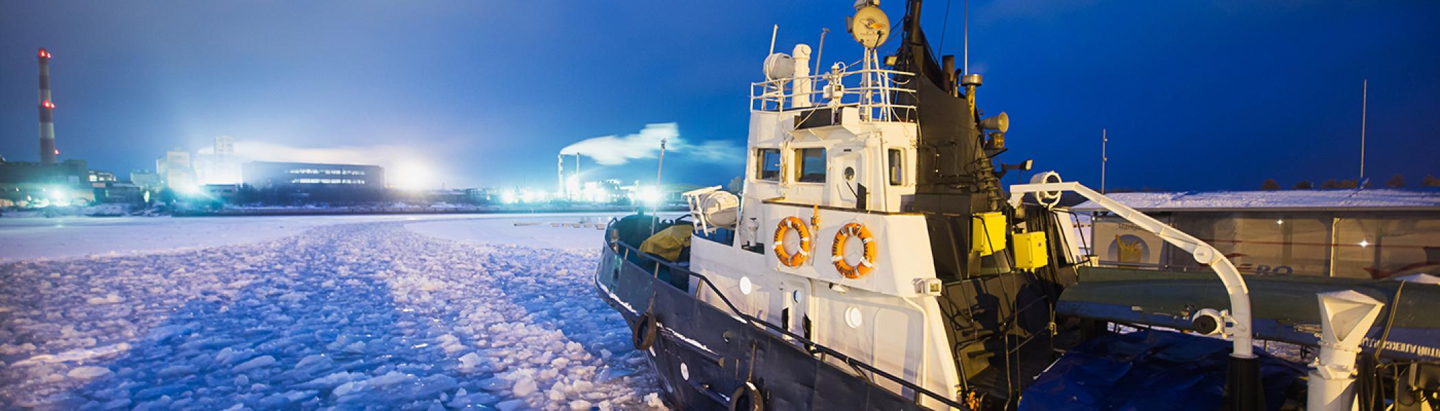 Icebreaking ship in the North Pole in the evening lights