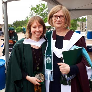 Maddy MacNab MA'18 with Director Joan Sangster at convocation in regalia
