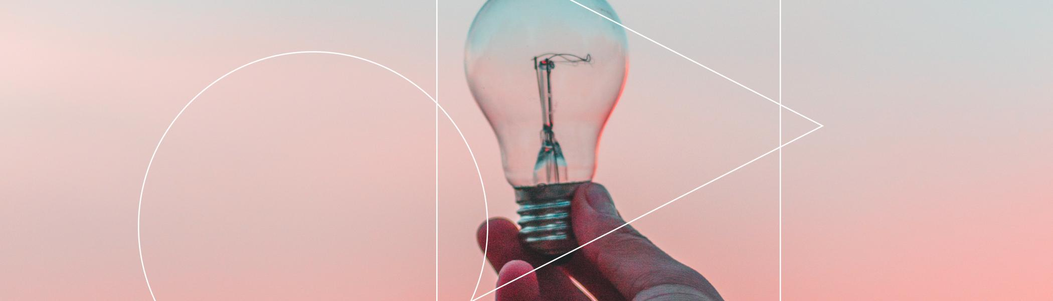A light bulb being held up