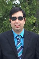 Brian Srivastava wearing a black suit and dark sunglasses