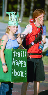 "Two traillites, one wearing ""the happy box,"" participating in o-week event."