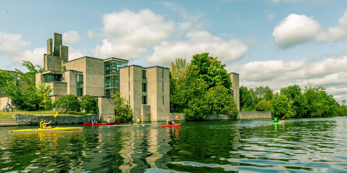 Scenic view of the Otonabee River and the Champlain College behind it