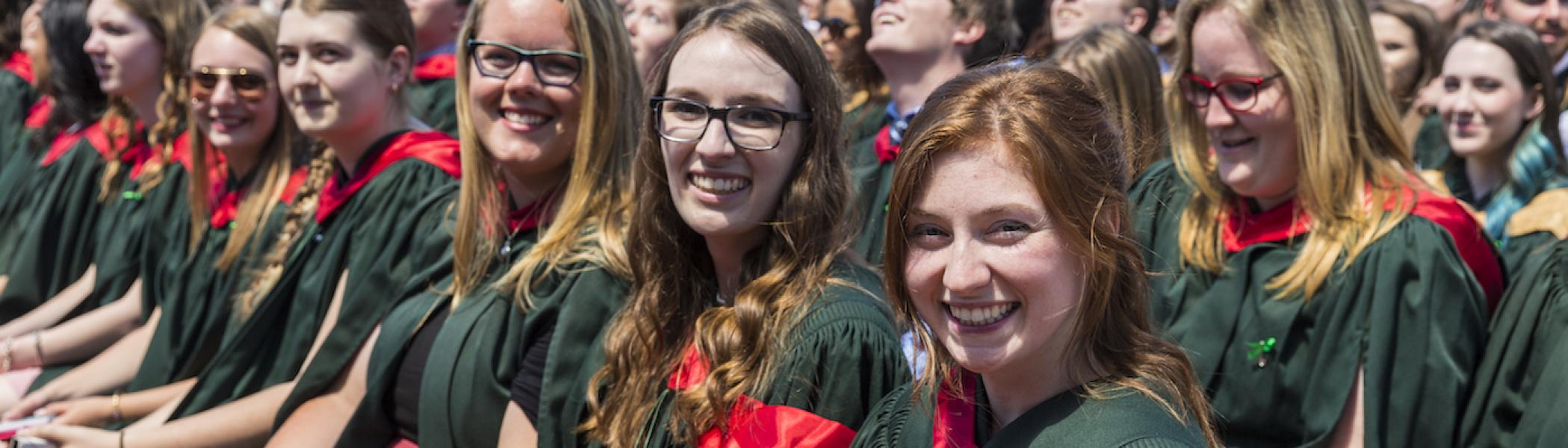 A group of girls smiling at their convocation