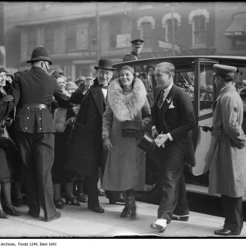 Flora McCrae Eaton and son John David Eaton exiting vehicle at opening of store on College Street