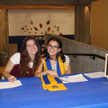 College Ambassadors sitting at table