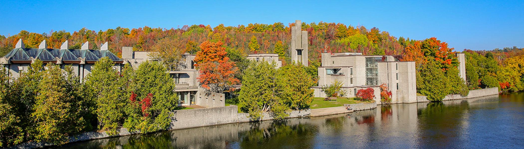 Exterior view of Champlain college buildings in amongst the fall trees on a sunny fall afternoon