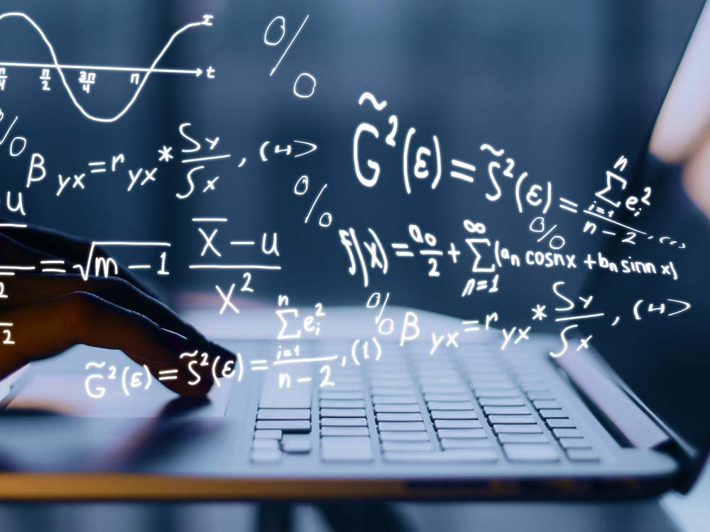 Picture of math equations and a computer