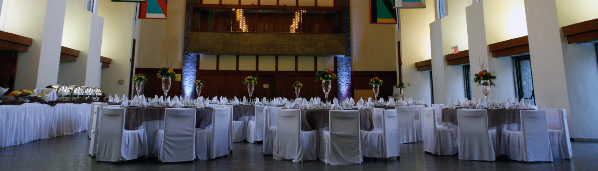 Tables set up for a wedding in the Great Hall
