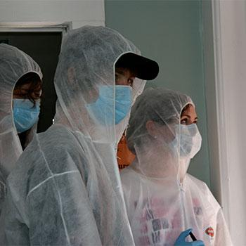 Students suited up in white scrubs and masks for the Trent University Forensic Science camp.