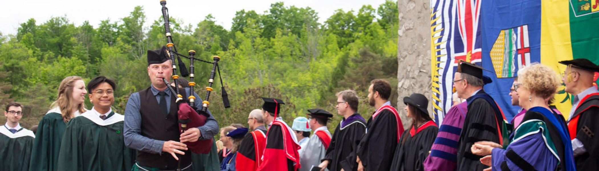 Piper leading the graduates into the convocation ceremony.