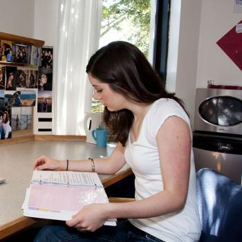 Student studying in residence room