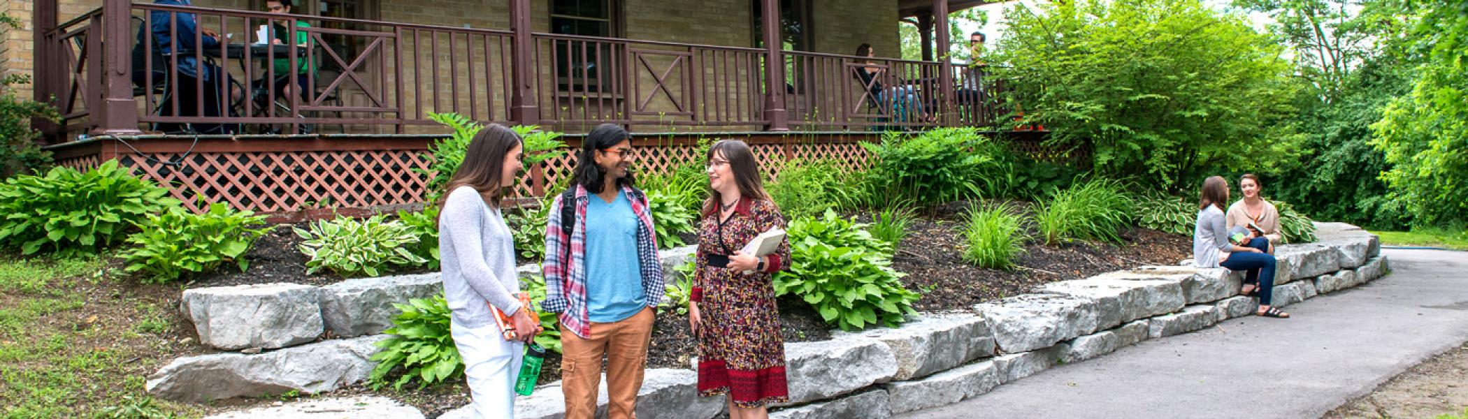 Students conversing outside at Traill College.