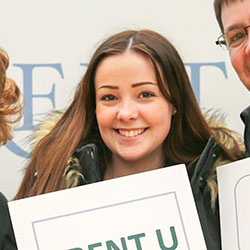 New student holding Trent U Bound sign