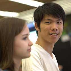 Student looking into camera and smiling