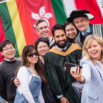 Graduating class from Trent International pose with Trent University President Leo Groake.
