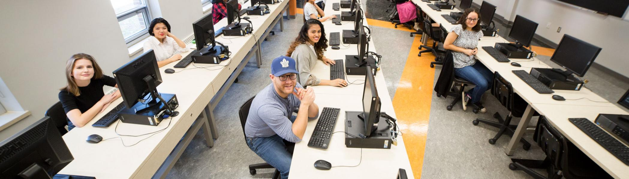 Trent University Durham GTA students working in a computer lab