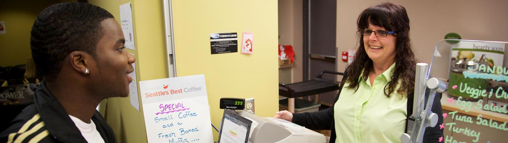 A Trent University Durham student making an order at Trent Cafe