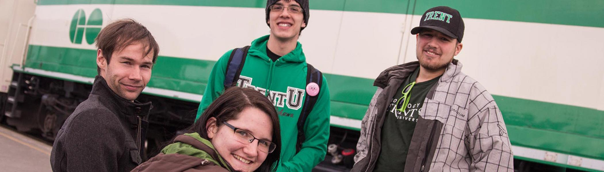 Trent University Durham students are standing in front of the GO train