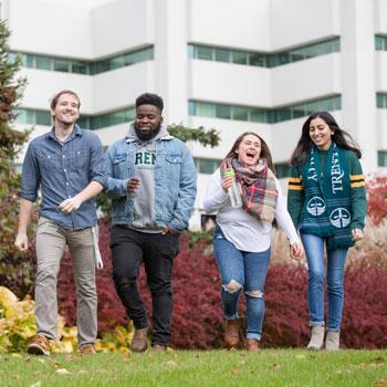 4 Students walking outside