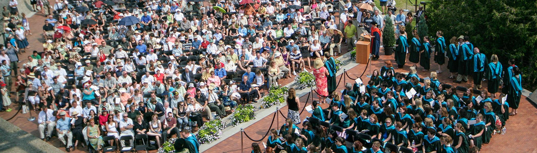 Aerial view of the Teacher Education class outside on the Bata library podium on a bright summer's morning