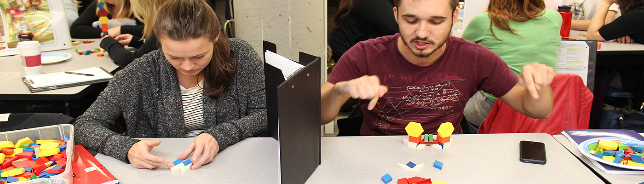 Teacher Candidates playing the math barrier game during class