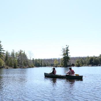 students canoeing in lovesick lake