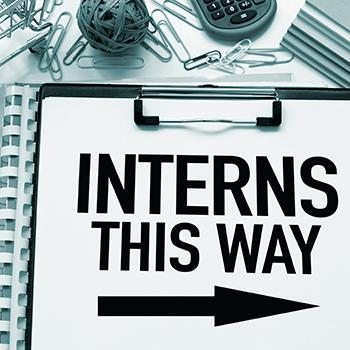 Interns This Way sign