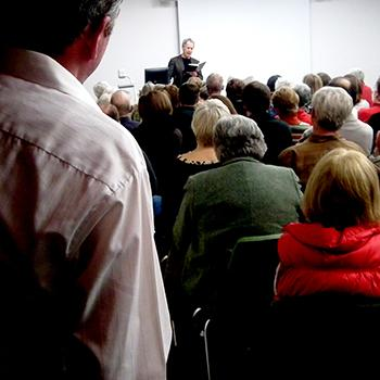 Linden MacIntyre reading to a group of people