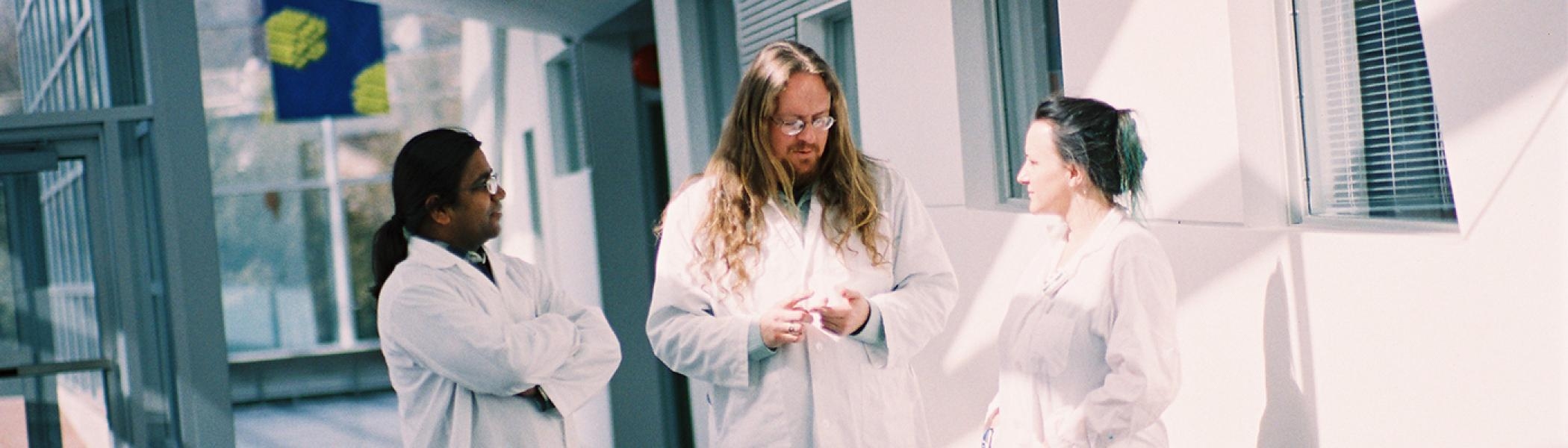 Chemistry Professor with students in hallway of Chemical Sciences Building
