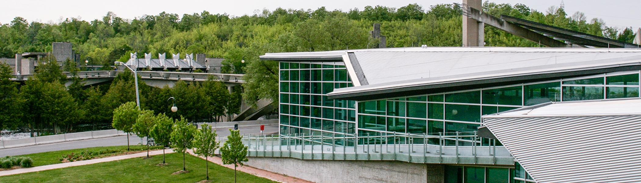 Exterior view of the chemistry building across the Otonabee river