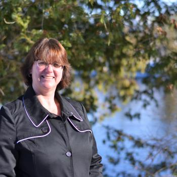 Image of Kim Bergeron standing by the Otonabee River