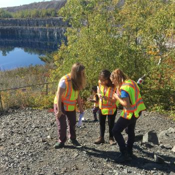 two students and a teaching assistant sampling mine tailings in the field