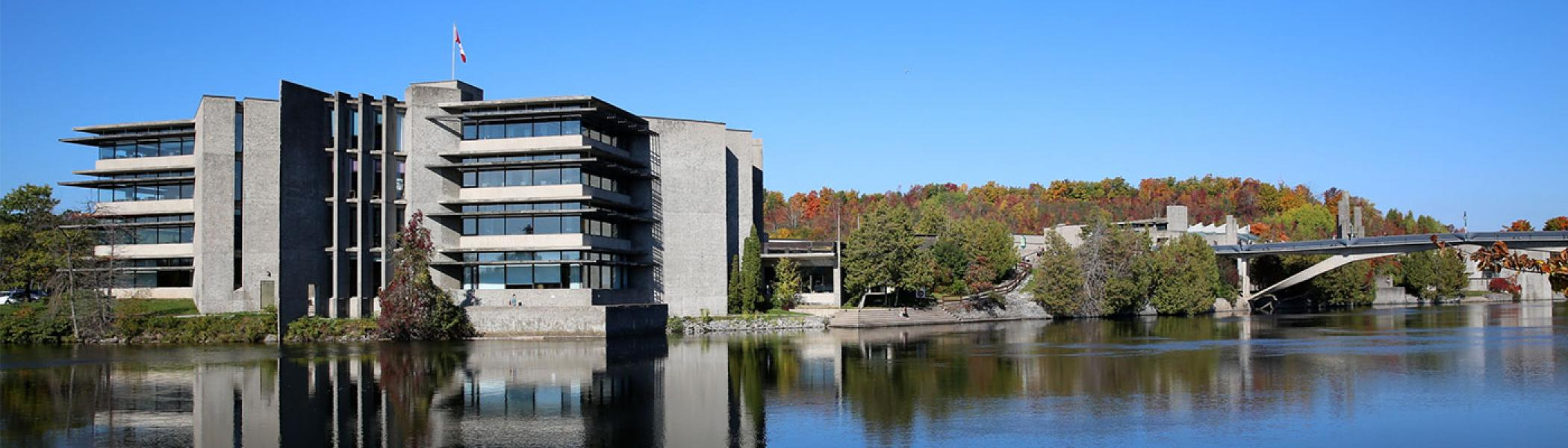 Bata library in the fall taken from across the Otonabee river.