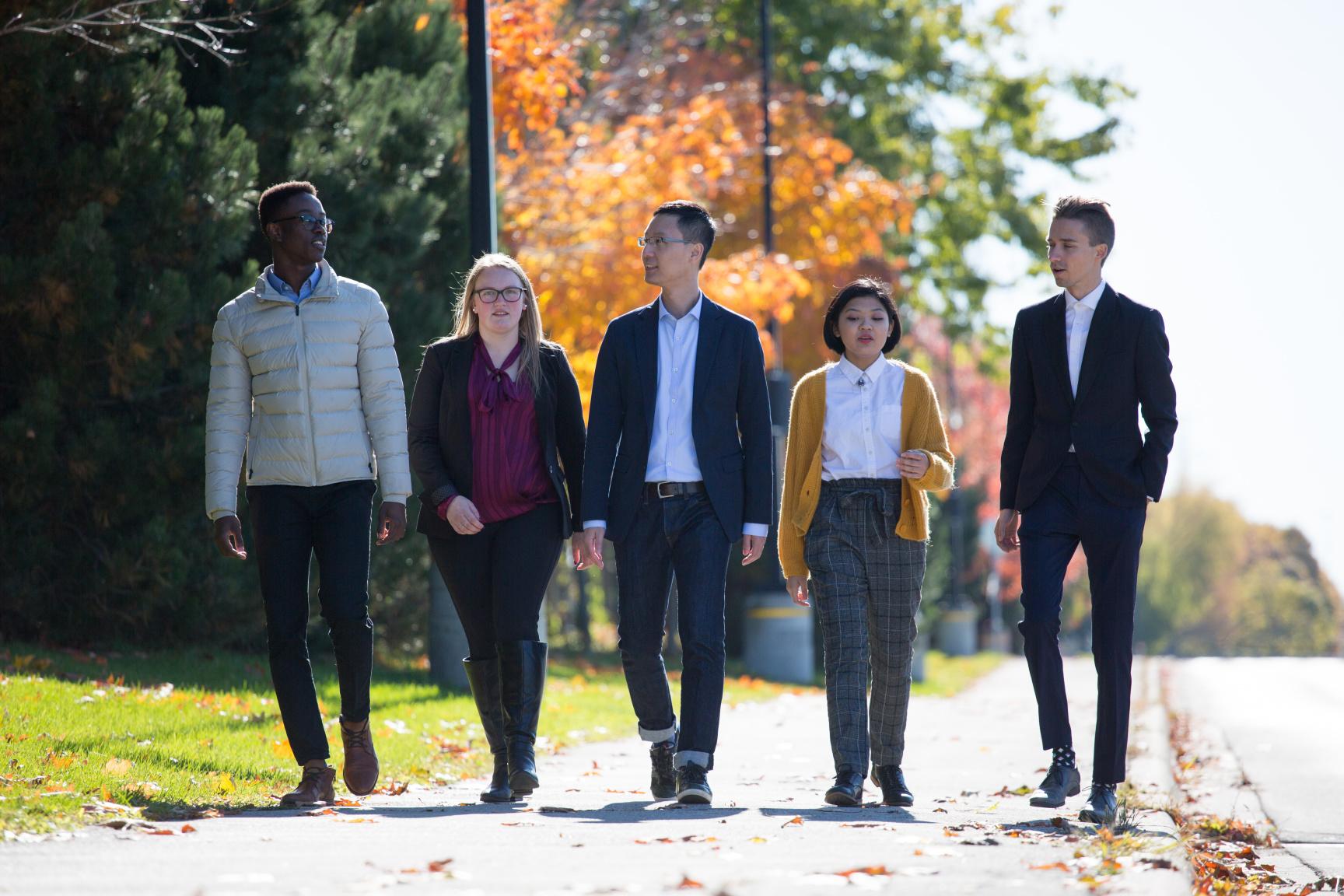Trent University Durham GTA students walking outside together.