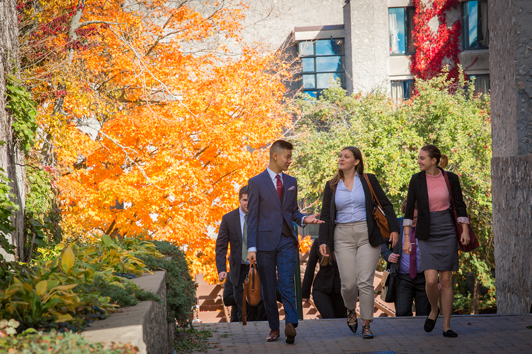 Accounting students walking through Trent University campus in the fall